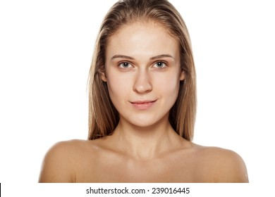 smiling young blond woman posing on a white background