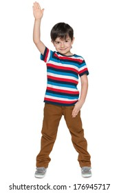 A smiling young boy stretching his right hand up on the white background
