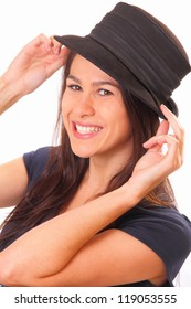 Smiling young brunette woman in a hat
