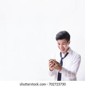 Smiling young business man being surprised as reading message at smartphone in his hand with white background and copyspace.