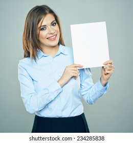 Smiling young business woman hold white business board. blank card. copy space. studio isolated.