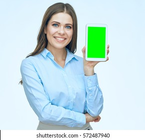 Smiling young business woman presenting tablet with empty screen. Isolated.