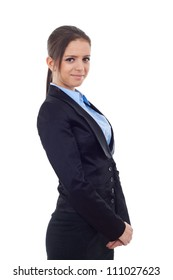Smiling young business woman standing and holding her hands together. Looking at the camera, on white background
