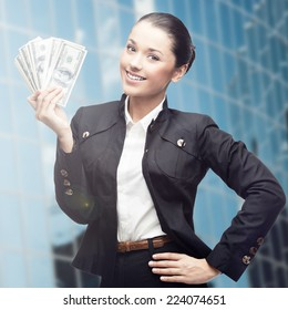 smiling young business woman standing over blue background
