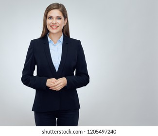 Smiling young business woman wearing black suit isolated portrait.