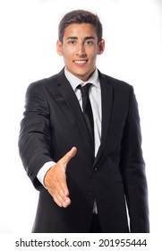 Smiling young businessman giving a hand isolated on white background