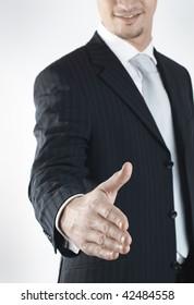 smiling young businessman offering handshake
