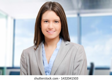 Smiling young businesswoman portrait in her office