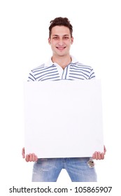 Smiling young casual man holding white sign to write it on your text isolated on white background