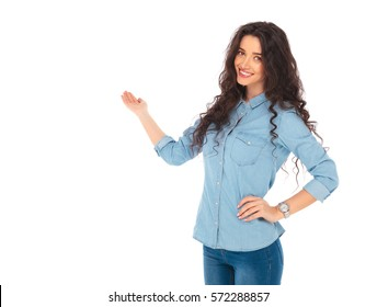 smiling young casual woman presenting on white background