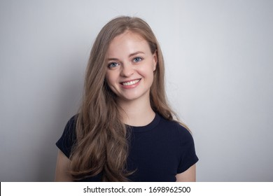 Smiling young caucasian girl woman, looking happy and positive