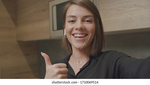 Smiling young caucasian woman blogger vlogger influencer sit at home speaking looking at phone camera talking making conference call record , lifestyle blog vlog, smartphone view