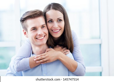 Smiling young couple hugging