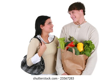 Smiling Young Couple Looking at Each Other with Groceries Shopping Items