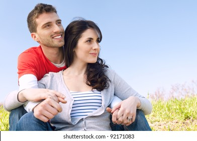 Smiling young couple looking together at their future