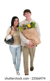 Smiling Young Couple Walking with Groceries Shopping Items