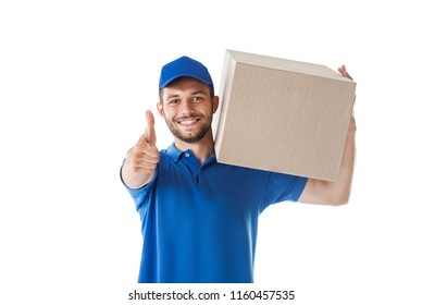 Smiling young delivery man with parcel box showing thumbs up isolated on white background. success concept