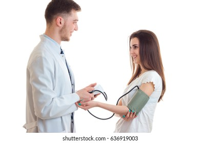 smiling young doctor takes girl pressure