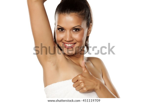 smiling young ethnic woman shows her shaved armpit and showing thumbs up
