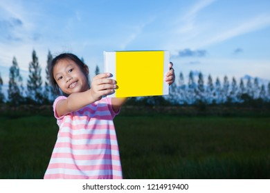Smiling young girl with holding a empty box