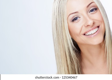 Smiling young girl on a white background