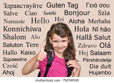 Smiling young girl showing thumb up with hello greeting in many different languages