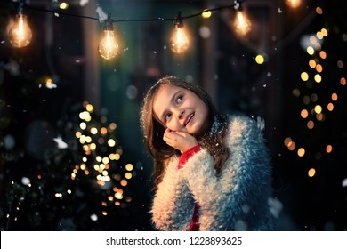 smiling young girl in a winter frosty evening
