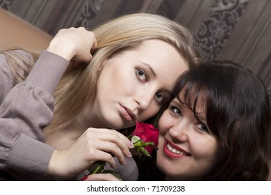 Smiling young girls with a flower