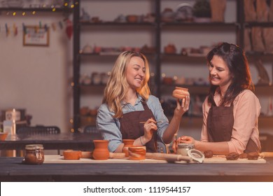 Smiling young girls in a master class in pottery