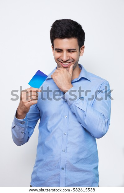 Smiling Young Handsome Man Holding Credit Card