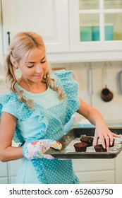 Smiling young housewife. Cooking baking in the kitchen