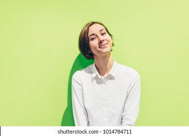 Smiling young lady (green background)