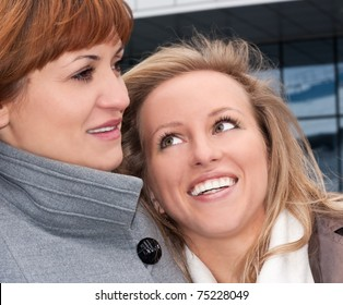 Smiling young lady with her friend