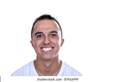 smiling young Latino on white background