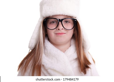 smiling young little girl  in warm white hat