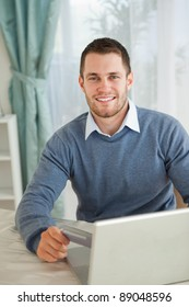 Smiling young male happy about his online shopping