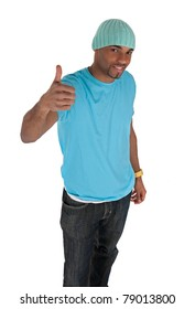 Smiling young man in a. blue with thumb up. Isolated on white background.