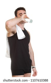 smiling young man holding towel and a bottle of water on an isolated background