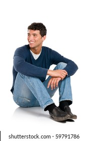 Smiling young man looking away with embarassement isolated on white background