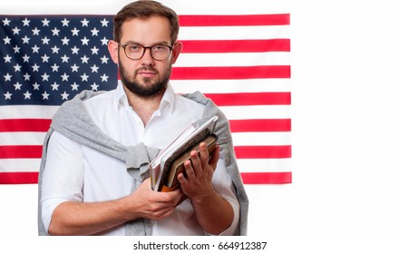 Smiling young man on United States flag background. Student is learning English as a foreign language. American flag.