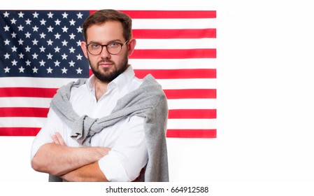 Smiling young man on United States flag background. Student is learning English as a foreign language. American flag