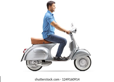 Smiling young man riding a vintage scooter isolated on white background