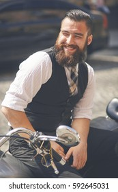 Smiling young man  sitting on a motorbike