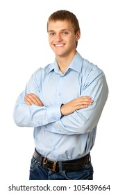Smiling young man standing with his arms folded against white background