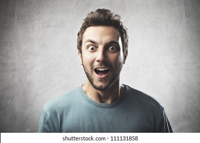 Smiling young man with surprised expression