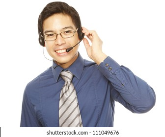 A smiling young man wearing a headset (isolated on white)