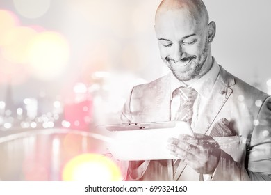 Smiling young man working with a touch pad double exposure