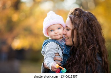 Smiling Young Mother Holding Baby