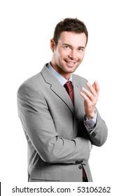 Smiling young natural businessman explaining isolated on white background