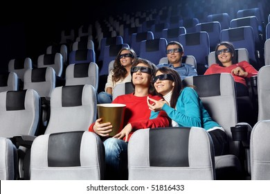 Smiling young people look cinema in 3d